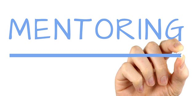 """Hand writing the word """"Mentoring"""""""